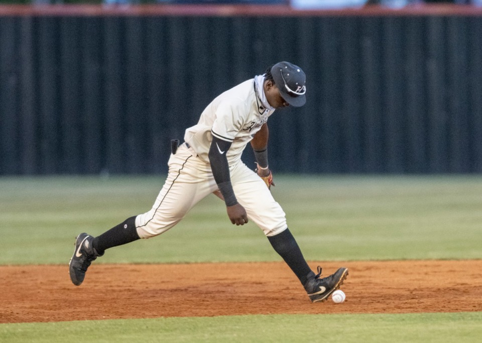 <strong>Houston shortstop Pierre Seals (5) drops a Brighton line drive on Friday, May 21, 2021.</strong> (Greg Campbell/Special to The Daily Memphian)