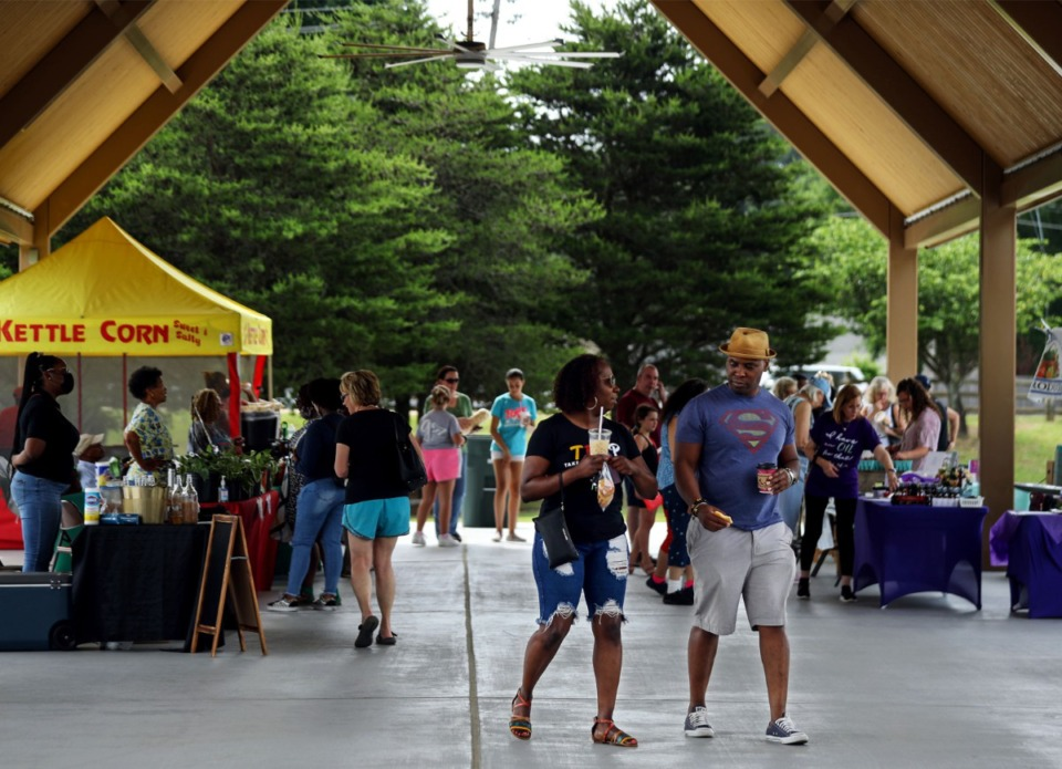 <strong>Shoppers browse Saturday, May 22 at Bartlett Station Farmers Market, which has moved to its new location at A. Keith McDonald Pavilion at Freeman Park.</strong> (Patrick Lantrip/Daily Memphian)