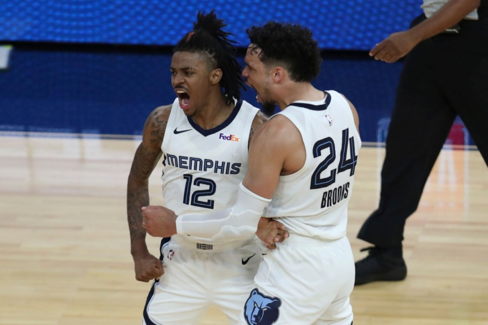 <strong>Memphis Grizzlies' Ja Morant (left) is congratulated by Dillon Brooks after scoring against the Golden State Warriors during overtime in an NBA basketball Western Conference play-in game in San Francisco, Friday, May 21, 2021.</strong> (Jed Jacobsohn/AP)