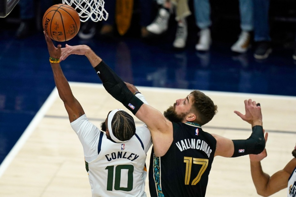 <strong>Memphis Grizzlies center Jonas Valanciunas (17) defends against Utah Jazz guard Mike Conley (10) during the first half of Game 1 of their NBA basketball first-round playoff series Sunday, May 23, 2021, in Salt Lake City.</strong> (Rick Bowmer/AP)