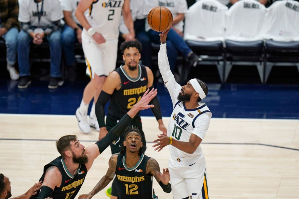 <strong>Utah Jazz guard Mike Conley (10) shoots as Memphis Grizzlies' Jonas Valanciunas, left, and Ja Morant (12) defend during the first half of Game 1 of their NBA basketball first-round playoff series Sunday, May 23, 2021, in Salt Lake City.</strong> (Rick Bowmer/AP)
