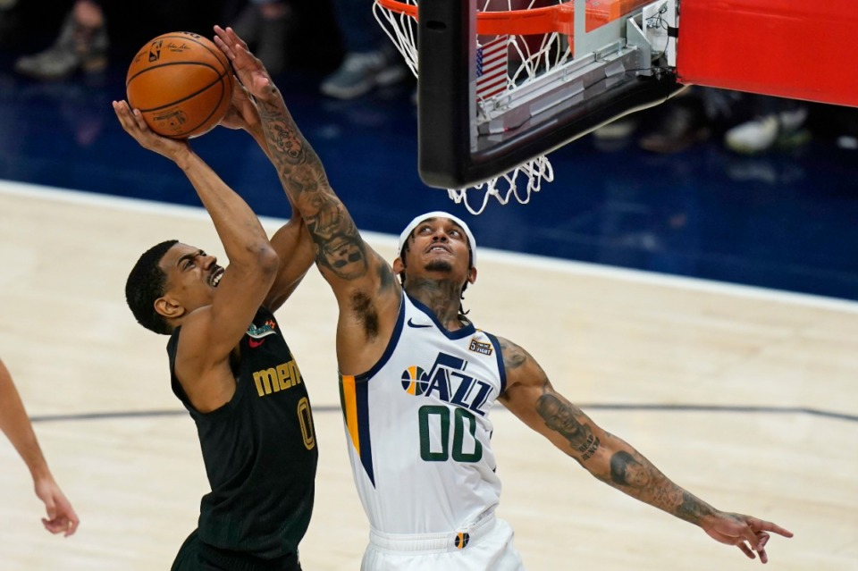 <strong>Utah Jazz guard Jordan Clarkson (00) blocks the shot of Memphis Grizzlies guard De'Anthony Melton (0) during the first half of Game 1 of their NBA basketball first-round playoff series Sunday, May 23, 2021, in Salt Lake City.</strong> (Rick Bowmer/AP)
