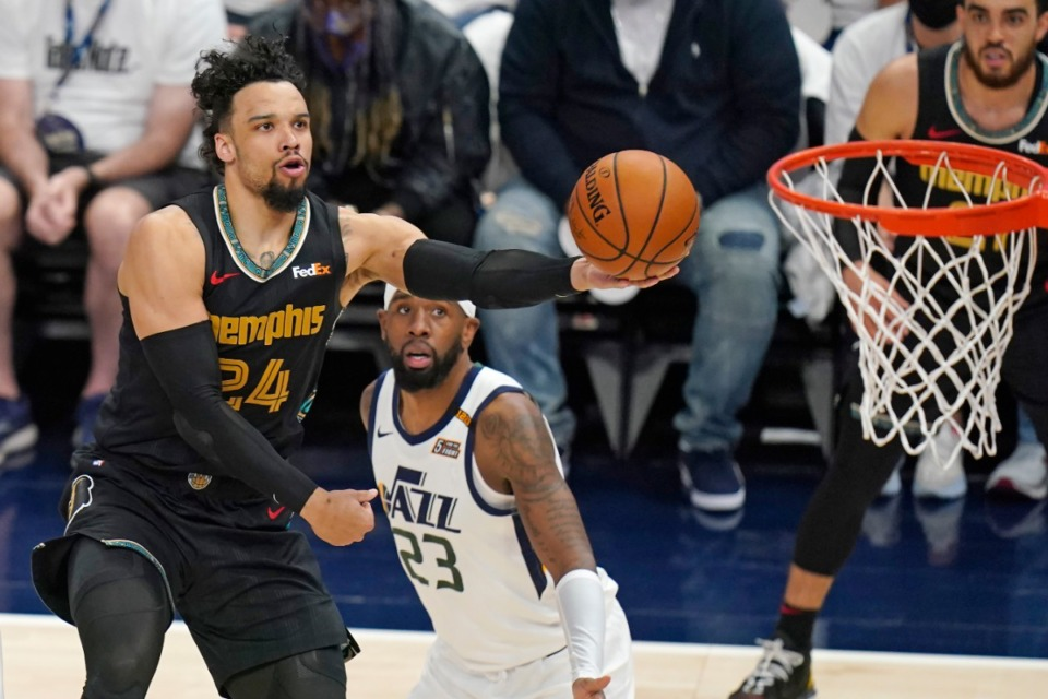 <strong>Memphis Grizzlies forward Dillon Brooks (24) lays the ball up as Utah Jazz forward Royce O'Neale (23) looks on during the first half of Game 1 of their NBA basketball first-round playoff series Sunday, May 23, 2021, in Salt Lake City.</strong> (Rick Bowmer/AP)
