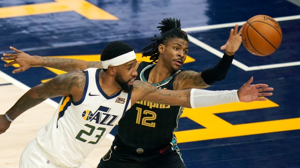 <strong>Utah Jazz forward Royce O'Neale (23) battles with Memphis Grizzlies guard Ja Morant (12) for a loose ball during the first half of Game 1 of their NBA basketball first-round playoff series, Sunday, May 23, 2021, in Salt Lake City.</strong> (Rick Bowmer/AP)