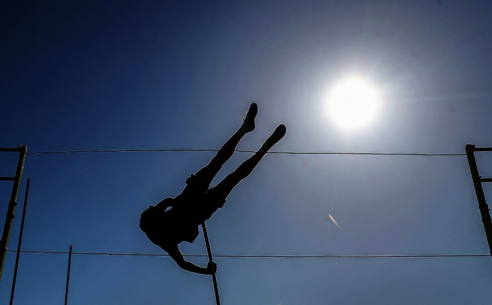 <strong>A pole vaulter practices at the May 13 region championship meet at MUS.</strong>&nbsp;(Patrick Lantrip/Daily Memphian)