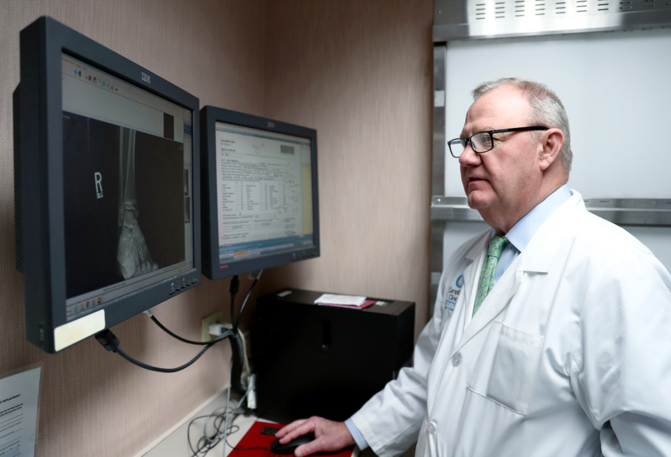 <strong>Dr. James H. Beaty, an orthopedic surgeon at Campbell Clinic, reviews a patient's X-ray chart Wednesday, Jan. 23, 2019.&nbsp;The local orthopedic practice is conducting clinical research on the efficacy of other pain treatments, including nerve freezing.&nbsp;</strong>(Houston Cofield/Daily Memphian)