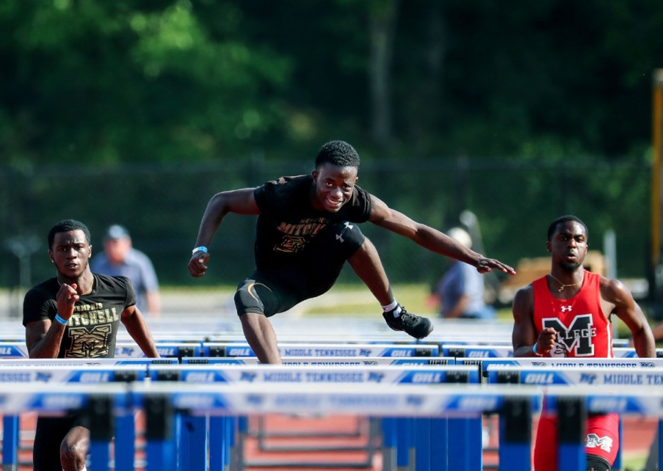 <strong>Mitchell High School standout Dorien Johnson clears the hurdles at the state championships in Murfreesboro, Tennessee on May 25, 2021</strong>. (Patrick Lantrip/Daily Memphian)