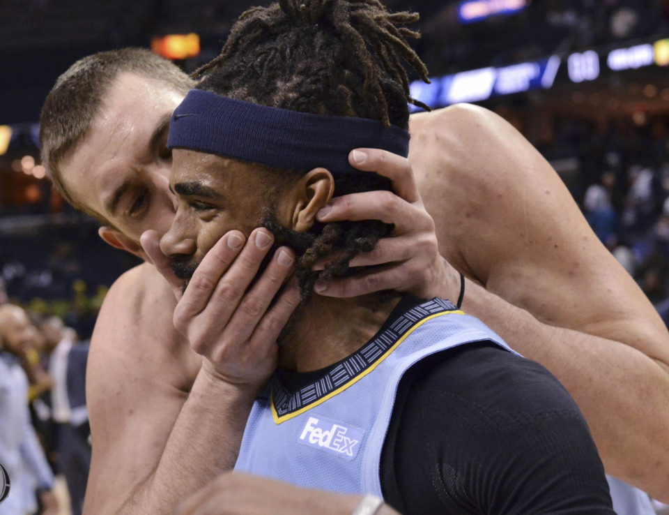 <span><strong>Memphis Grizzlies center Marc Gasol kisses guard Mike Conley after the team's NBA basketball game against the Indiana Pacers on Saturday, Jan. 26, 2019, in Memphis, Tenn.</strong> (AP Photo/Brandon Dill)</span>