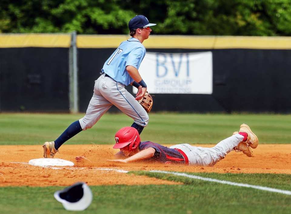 <strong>Tipton-Rosemark Academy's Will Hughes (9) slides into third base during a May 26, 2021 playoff game against Northpoint Christian School in Murfreesboro, Tennessee.</strong> (Patrick Lantrip/Daily Memphian)