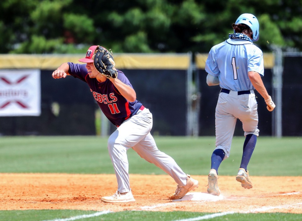 <strong>Tipton-Rosemark Academy first baseman Noah Roland (11) tries to beat a runner during a May 26, 2021 playoff game against Northpoint Christian School in Murfreesboro, Tennessee.</strong> (Patrick Lantrip/Daily Memphian)