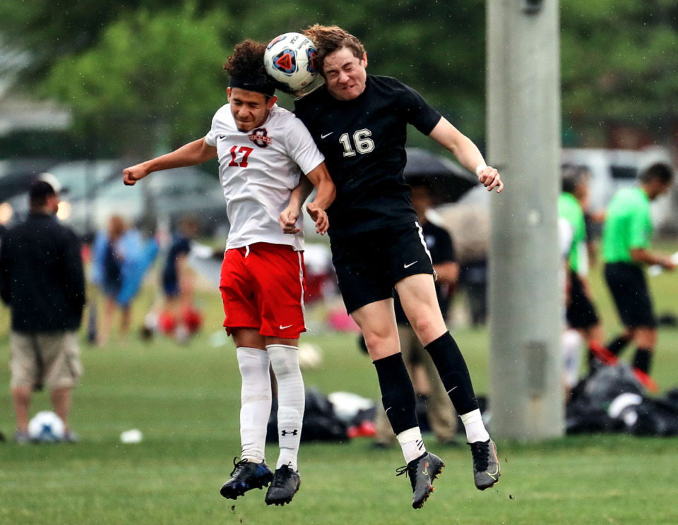<strong>Houston High School defender Cage Warmth (16) goes up for a header during the state championship semifinal game against Oakland High School in Murfreesboro, Tennessee May 26, 2021.</strong> (Patrick Lantrip/Daily Memphian)