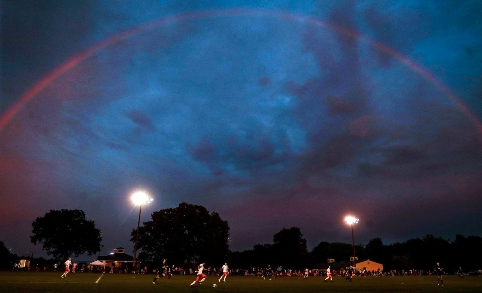 <strong>A rainbow forms in the sky over the field during the state championship semifinal match between Houston High School and Oakland High School in Murfreesboro, Tennessee May 26, 2021.</strong> (Patrick Lantrip/Daily Memphian)