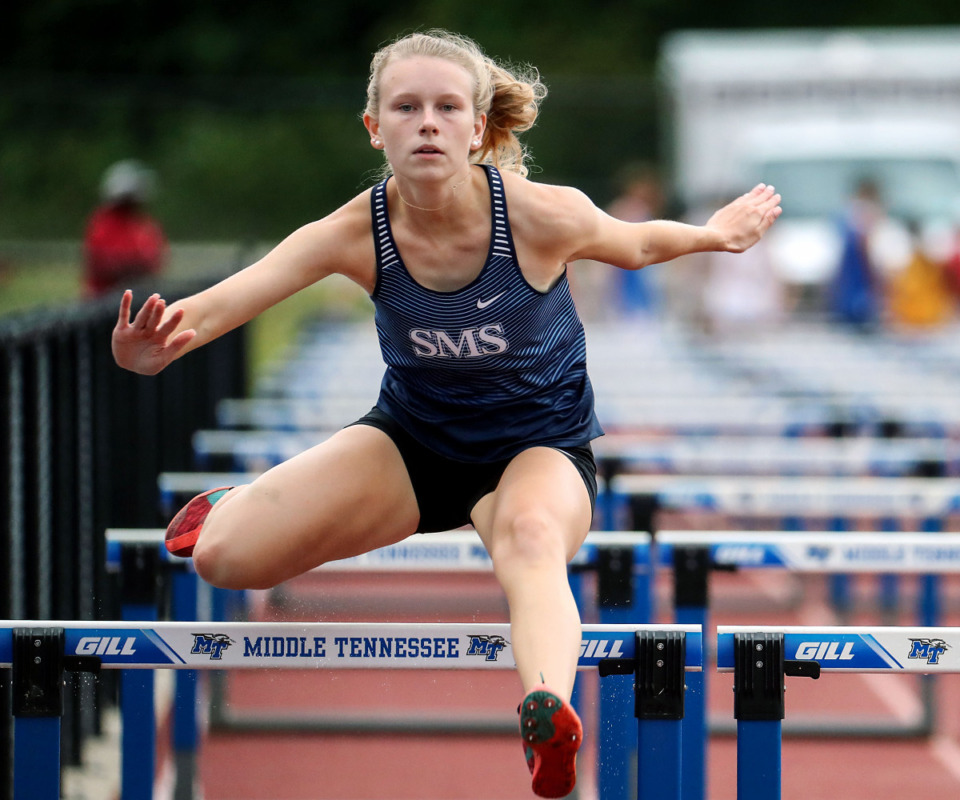 <strong>St. Mary's Episcopal School's Sydney Graeter clears the final hurdle during the 100-meter hurdles at the state championships in Murfreesboro, Tennessee May 26, 2021.</strong> (Patrick Lantrip/Daily Memphian)