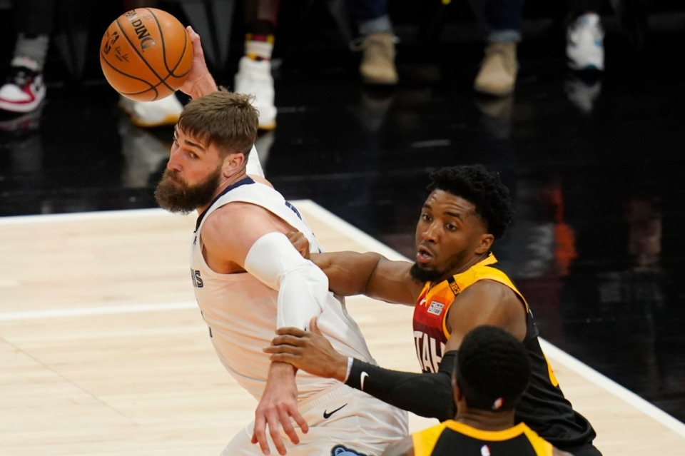<strong>Utah Jazz guard Donovan Mitchell, right, guards Grizzlies center Jonas Valanciunas, left, during Game 2 of their NBA basketball first-round playoff series Wednesday, May 26, 2021, in Salt Lake City.</strong> (Rick Bowmer/AP)