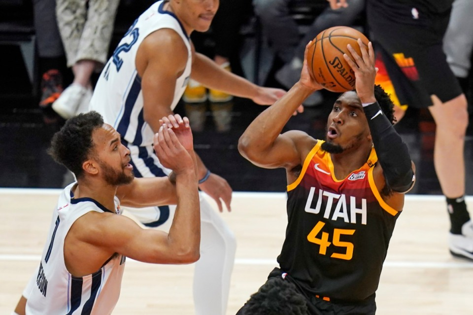 <strong>Utah Jazz guard Donovan Mitchell (45) goes to the basket as Grizzlies forward Kyle Anderson (1) defends during Game 2 of their NBA basketball first-round playoff series Wednesday, May 26, 2021, in Salt Lake City.</strong> (Rick Bowmer/AP)