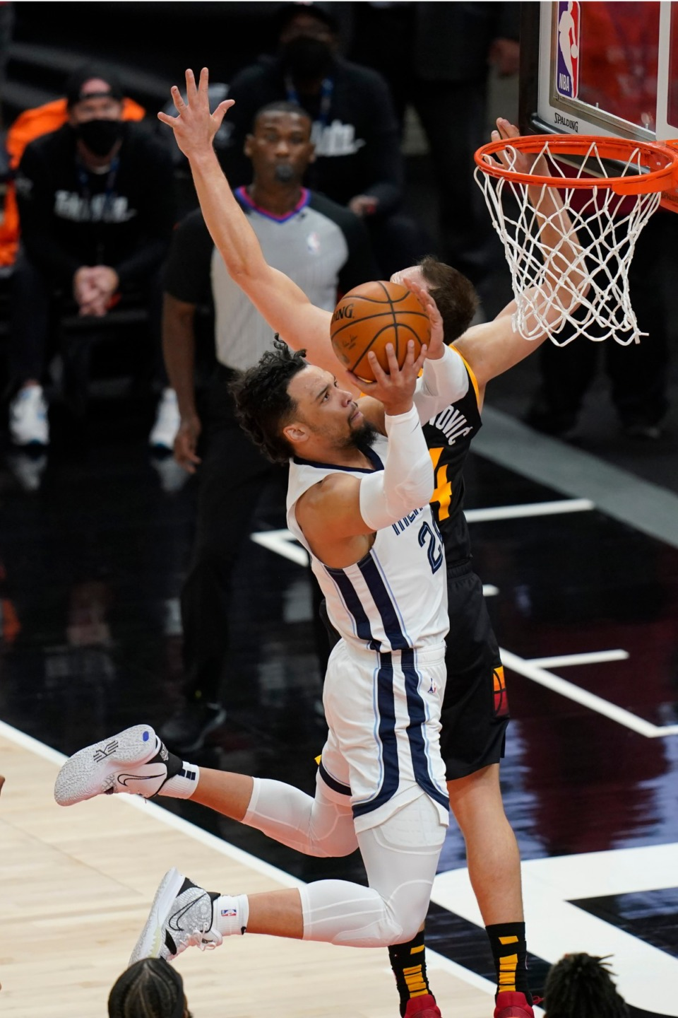 <strong>Grizzlies forward Dillon Brooks (24) goes to the basket as Utah Jazz forward Bojan Bogdanovic, rear, defends during Game 2 of their NBA basketball first-round playoff series Wednesday, May 26, 2021, in Salt Lake City.</strong> (Rick Bowmer/AP)