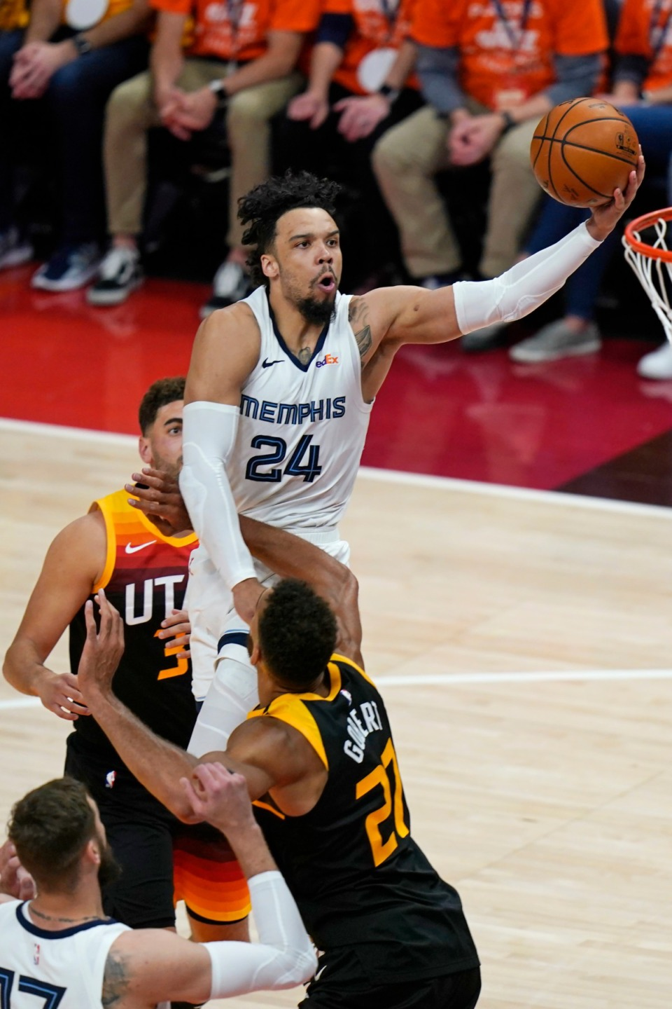 <strong>Grizzlies forward Dillon Brooks (24) lays the ball up as Utah Jazz center Rudy Gobert (27) defends during Game 2 of their NBA basketball first-round playoff series Wednesday, May 26, 2021, in Salt Lake City.</strong> (Rick Bowmer/AP)