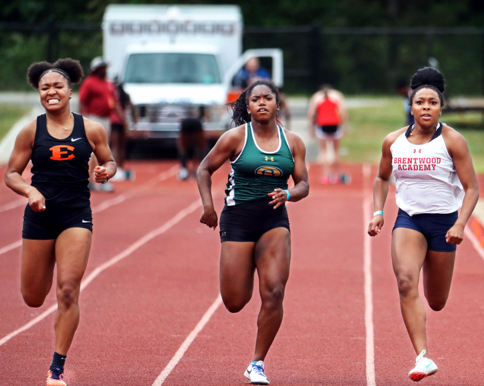 <strong>Briarcrest's Dalis Hawkins (center) runs in the 100-meter dash during the state championships in Murfreesboro, Tennessee May 26, 2021.</strong> (Patrick Lantrip/Daily Memphian)