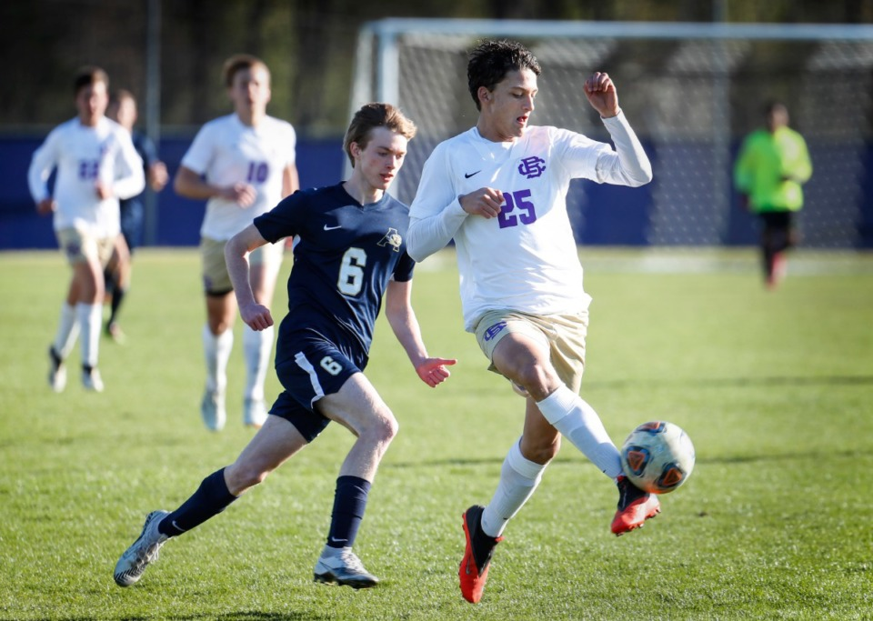 <strong>CBHS defender Hunter Lomasney (front) kicks the ball to the goalkeeper during action against Arlington on Thursday, April 1, 2021.</strong> (Mark Weber/The Daily Memphian file)