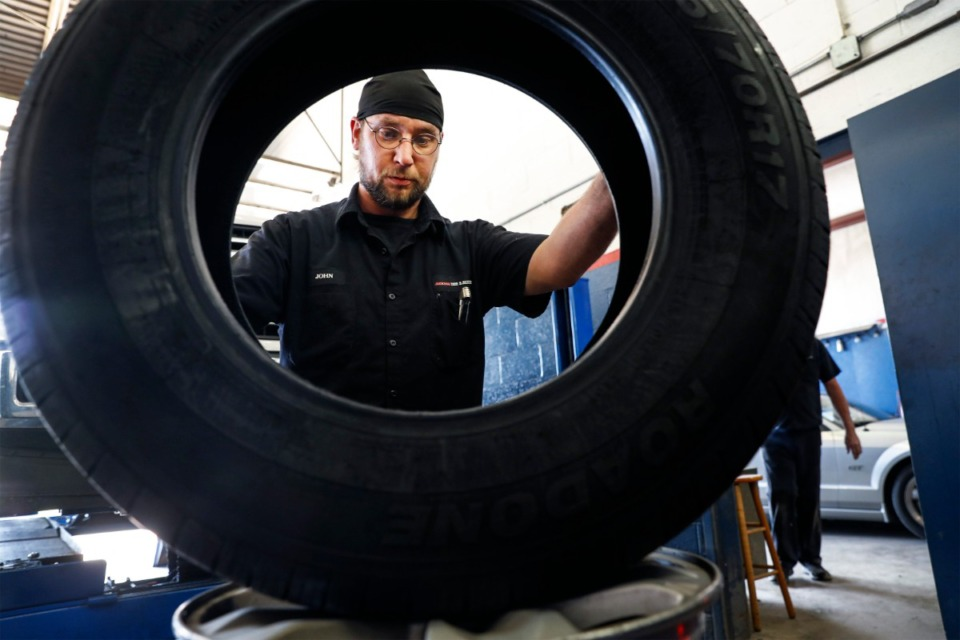 <strong>Jackson Tire and Alignment technician John Speer changes tires Thursday, May 20, 2021 on Jackson Ave.</strong> (Mark Weber/The Daily Memphian)