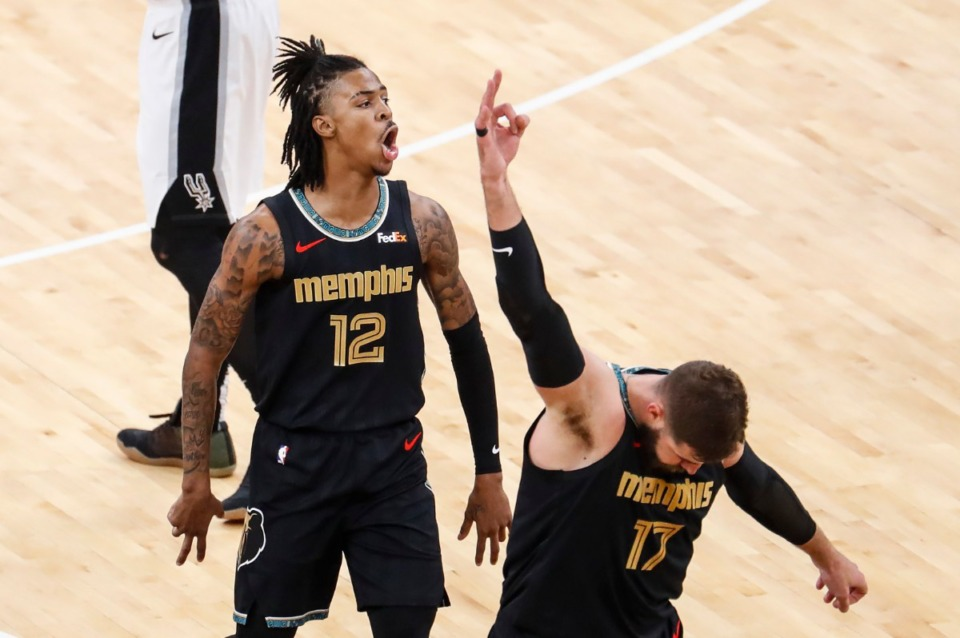 <strong>Memphis Grizzlies center Jonas Valanciunas (bottom) celebrates teammate Ja Morant&rsquo;s made 3-pointer during action against the San Antonio Spurs on Wednesday, May 19, 2021.</strong> (Mark Weber/The Daily Memphian)