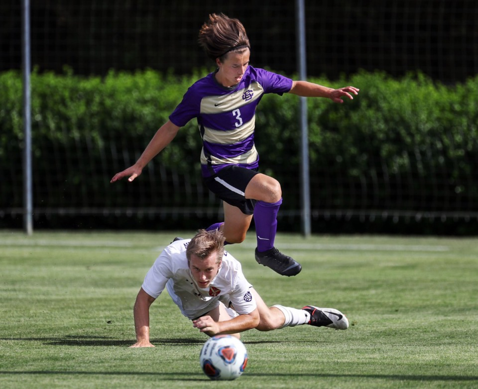 <strong>CBHS forward Hudson Carr (3) leaps over a Father Ryan defender during the state championship game in Murfreesboro, Tennessee, May 27, 2021.</strong> (Patrick Lantrip/Daily Memphian)