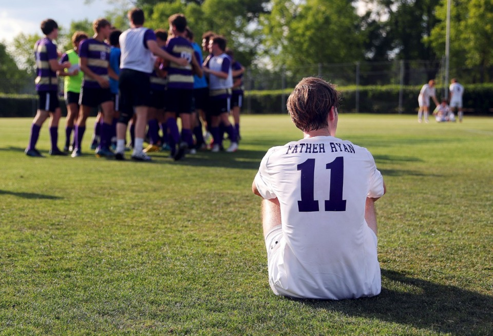 <strong>A lone Father Ryan player sits disconsolately after losing in the state championship game while CBHS players celebrate in the background in Murfreesboro, Tennessee, May 27, 2021.</strong> (Patrick Lantrip/Daily Memphian)