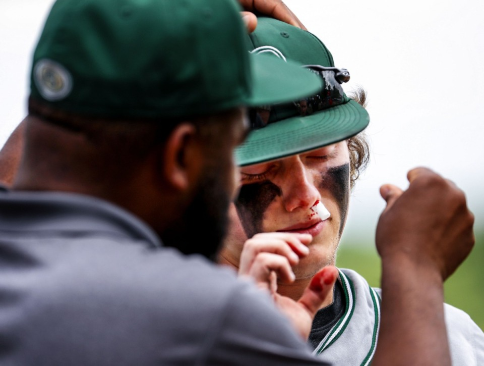 <strong>Briarcrest Christian School outfielder Eli Smith (6) gets treated for a bloody nose during the state championship game in Murfreesboro, Tennessee against Baylor High School May 27, 2021.</strong> (Patrick Lantrip/Daily Memphian)