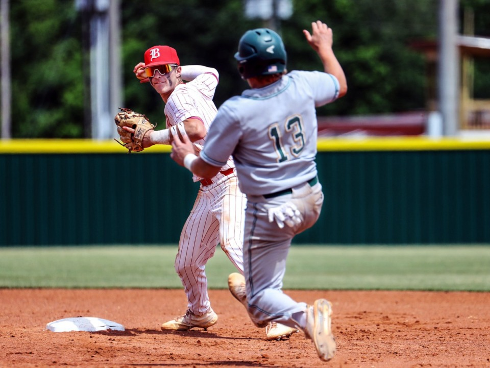 <strong>Briarcrest Christian School third baseman Tyler Harrington (13) tries to break up the double play during the state championship game in Murfreesboro, Tennessee against Baylor High School May 27, 2021.</strong> (Patrick Lantrip/Daily Memphian)