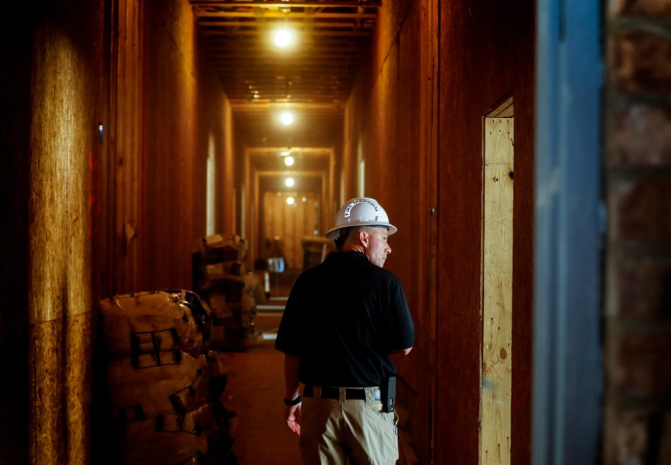 <strong>A fire marshal does inspections as construction continues on phase one of the mixed-use Lakeland Town Square development on Monday, May 24, 2021.</strong> (Mark Weber/The Daily Memphian)