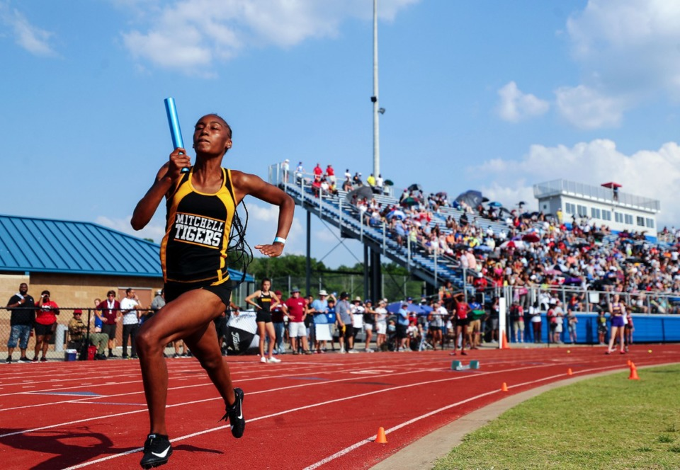<strong>A runner with Mitchell High School's 4x200 meter relay race takes the baton during the state championships in Murfreesboro, Tennessee May 25, 2021.</strong> (Patrick Lantrip/Daily Memphian)