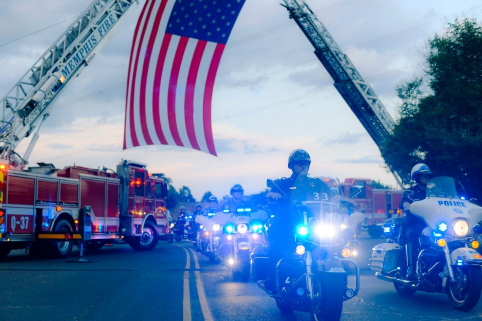 <strong>Hundreds of police officers across Shelby County gathered in the parking lot of Hope Presbyterian Church before driving a 40 mile route around Memphis in honor of Officer Christopher Scott &ldquo;Scotty&rdquo; Triplett. Triplett was killed last week after he was struck by a car while riding his motorcyle in a motorcade near Hickory Hill.</strong> (Houston Cofield/Special to The Daily Memphian)