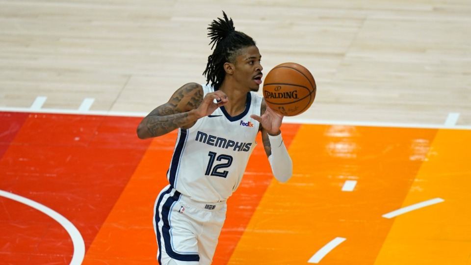 <strong>Memphis Grizzlies guard Ja Morant (12) brings the ball up court during the second half of Game 2 of their NBA basketball first-round playoff series against the Utah Jazz Wednesday, May 26, 2021, in Salt Lake City.</strong> (AP Photo/Rick Bowmer)