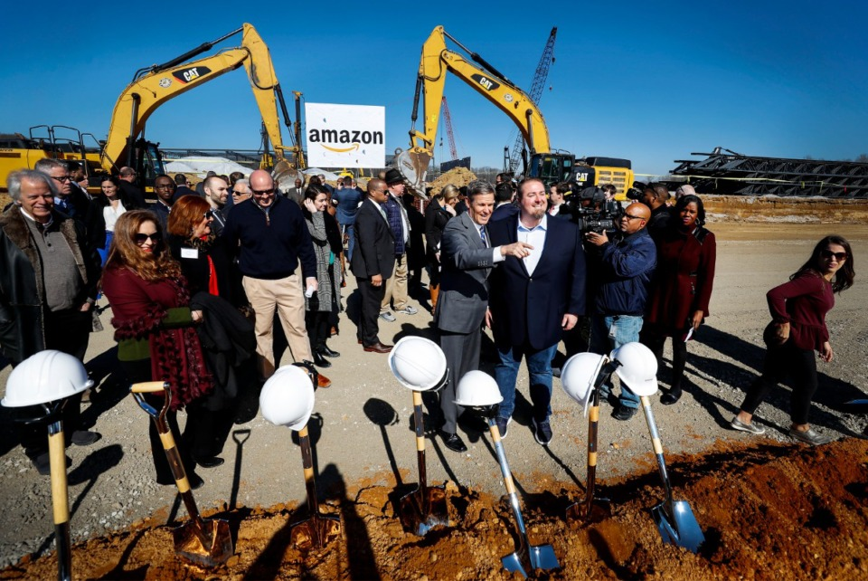 <strong>Tennessee Gov. Bill Lee (middle left) and Amazon director of regional operations Rob Packett (middle right) attended the press conference on Jan. 27, 2020, announcing the new Amazon fulfillment center on the Raleigh/Frayser border.</strong> (Mark Weber/Daily Memphian file)