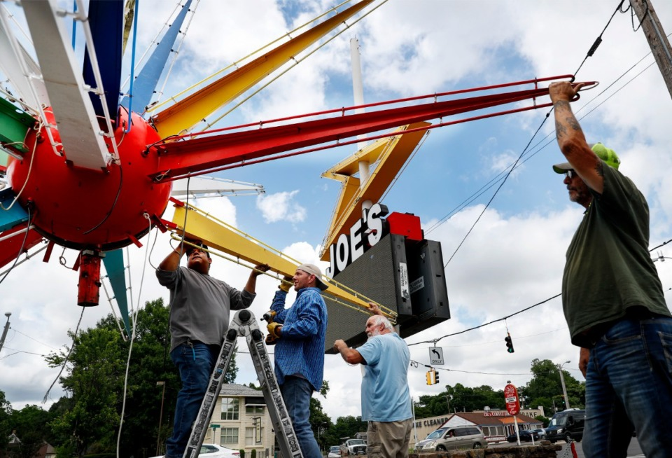 <strong>Balton Sign Co. crew members&nbsp; reinstall Joe&rsquo;s Wines &amp; Liquor&rsquo;s &ldquo;Sputnik&rdquo; business sign on Friday, May 28.&nbsp;The 59-year-old sign was given its nickname because it looks a bit like the world&rsquo;s first satellite, Sputnik, launched by the Soviet Union in 1957.</strong> (Mark Weber/Daily Memphian)