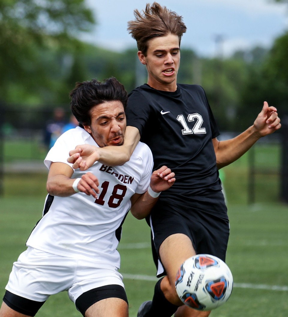 <strong>Bearden High School forward Sharif Aly (18) and Houston High School defender Cole Hutchison (12) fight for the ball in the Division 1 Class AAA championship game in Murfreesoro, Tennessee, on May 28, 2021.</strong> (Patrick Lantrip/Daily Memphian)