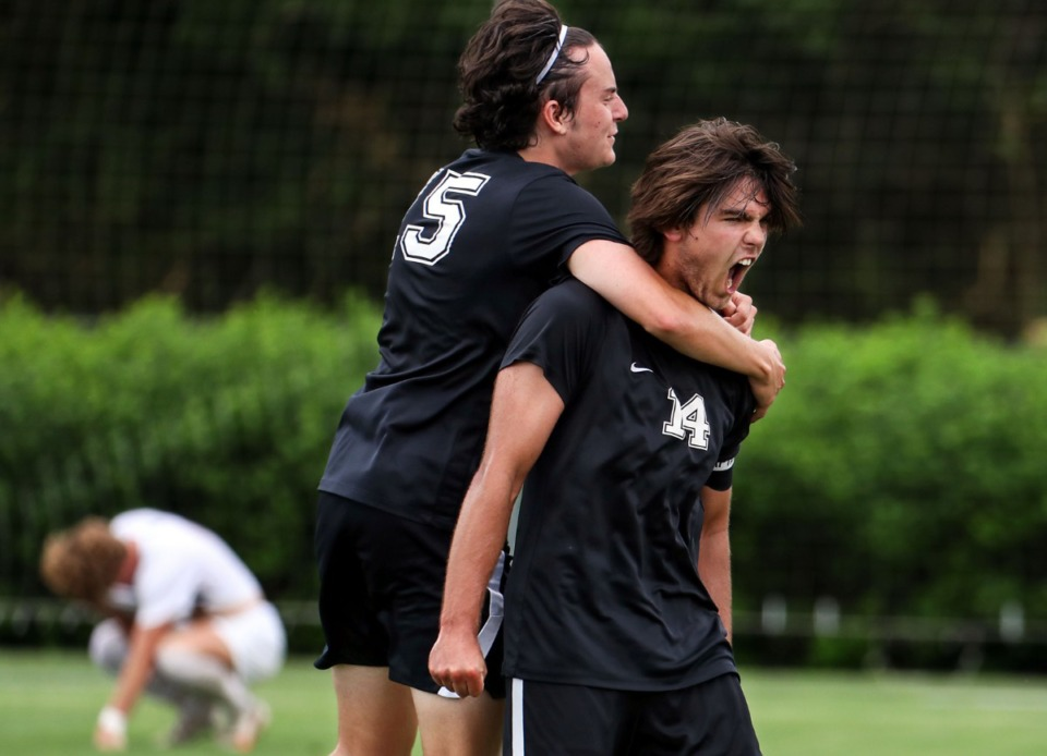 <strong>Houston High School senior Zach Campbell (15) jumps on senior captain Parker Humphrey (14) after winning the school&rsquo;s seventh soccer championship May 28, against Bearden High School.</strong> (Patrick Lantrip/Daily Memphian)
