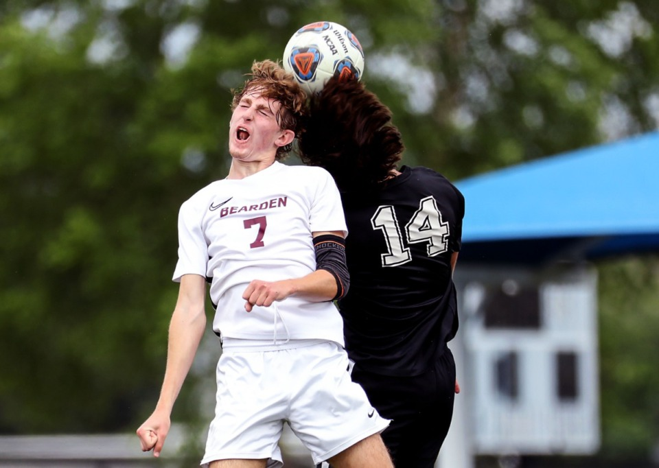 <strong>Houston High School midfielder Parker Humphrey (14) and Bearden High School midfielder Dylan Kolnick (7) go up for header in the Class AAA championship game in Murfreesoro, Tennessee, on May 28, 2021.</strong> (Patrick Lantrip/Daily Memphian)