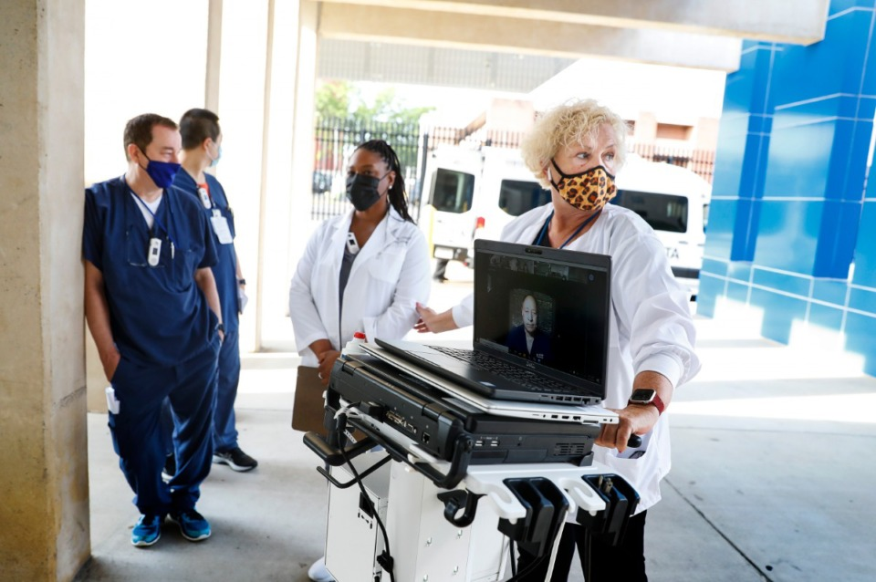 <strong>Beverly Massey (right), the simulation director at Memphis VA Medical Center, leads hospital staff members in a Telestroke simulated exercise on Thursday, May 27.</strong> (Mark Weber/Daily Memphian)