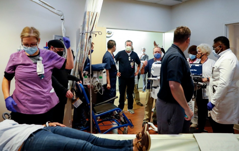 <strong>Memphis VA Medical Center staff members work with a stroke patient during a Telestroke simulated exercise on Thursday, May 27.</strong> (Mark Weber/Daily Memphian)