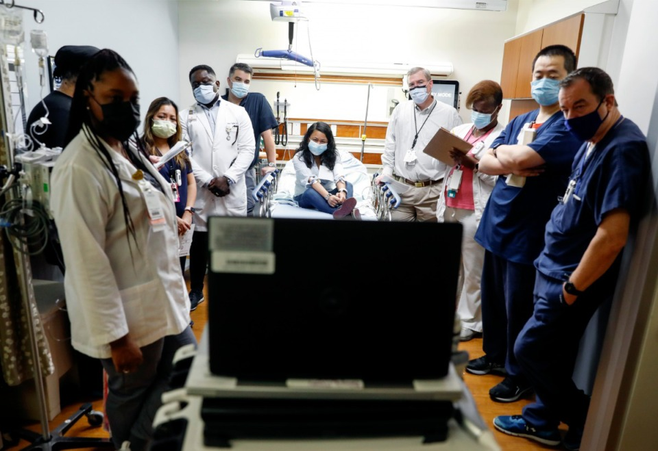 <strong>Memphis VA Medical Center staff members are debriefed after performing a Telestroke simulated exercise on Thursday, May 27.</strong> (Mark Weber/Daily Memphian)