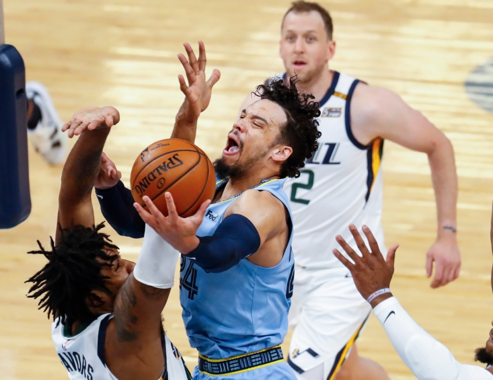 <strong>Memphis Grizzlies forward Dillion Brooks (middle) drives for a lay-up against the Utah Jazz defense during game three of the NBA Playoffs on Saturday, May 29, 2021.</strong> (Mark Weber/The Daily Memphian)