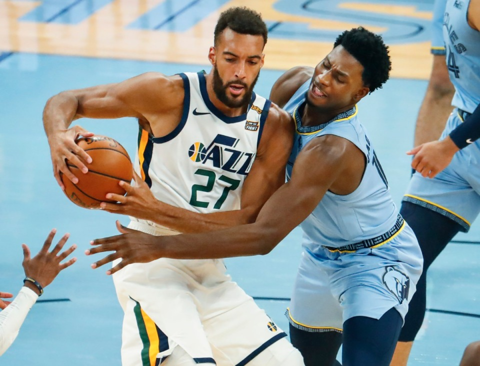 <strong>Memphis Grizzlies defender Jaren Jackson Jr. (right) battles Utah Jazz center Rudy Gobert (left) during game three of the NBA Playoffs on Saturday, May 29, 2021.</strong> (Mark Weber/The Daily Memphian)