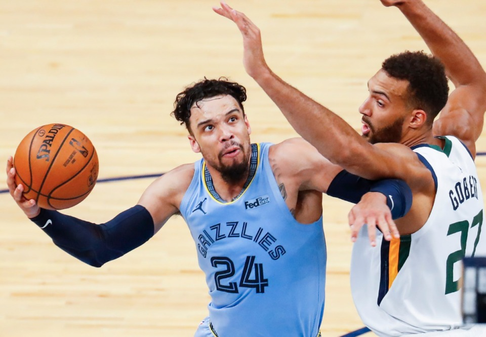<strong>Memphis Grizzlies forward Dillion Brooks (left) drives to the basket against Utah Jazz defender Rudy Gobert (right) during game three of the NBA Playoffs on Saturday, May 29, 2021.</strong> (Mark Weber/The Daily Memphian)