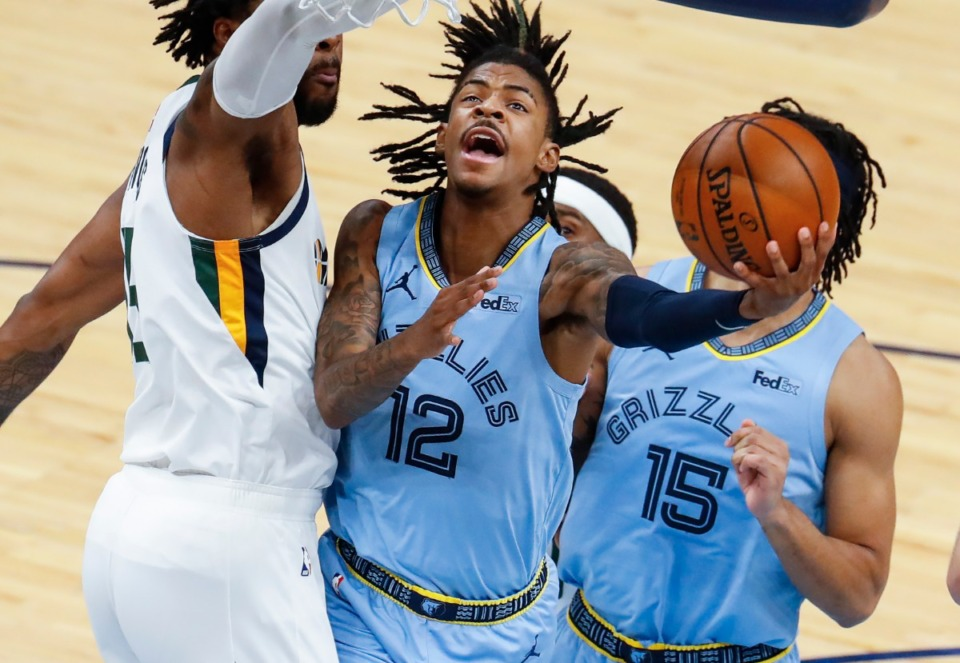 <strong>Memphis Grizzlies guard Ja Morant (middle) drives for a lay-up against the Utah Jazz defense during game three of the NBA Playoffs on Saturday, May 29, 2021.</strong> (Mark Weber/The Daily Memphian)
