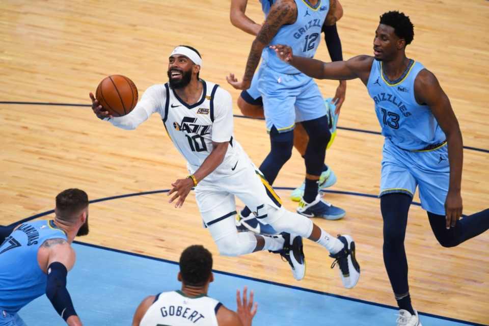 <strong>Utah Jazz guard Mike Conley (10) goes to the basket past Memphis Grizzlies forward Jaren Jackson Jr. (13) during the second half of Game 3 of an NBA basketball first-round playoff series Saturday, May 29, 2021, at FedExForum.</strong> (John Amis/AP)