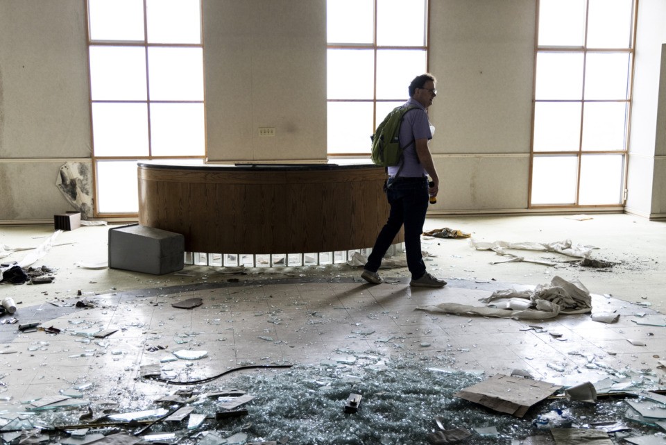 <strong>Brett Roler, vice president of development for the Downtown Memphis Commission, led a reporter and photographer on a tour of the vacant 100 North Main building on Sunday, May 30. The trio caught their breath by wandering through floors 14, 18, 21, 25, 28, 30, 34, 35, 36 and 37.</strong> (Brad Vest/Special to the Daily Memphian)
