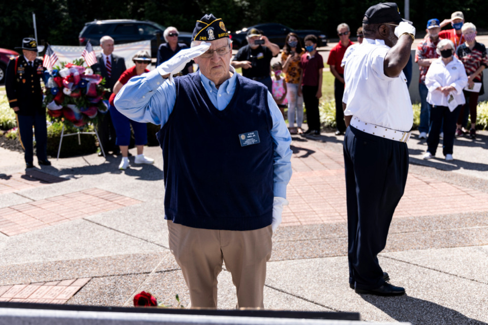 <strong>Steve Sims Jr., left, and John Wynn, right, place roses during a remembrance ceremony for Medal of Honor Recipients Vernon McGarrity and Walter K. Singleton during Monday&rsquo;s Memorial Day Ceremony at Veterans Park in Bartlett.</strong> (Brad Vest/Special to Daily Memphian)