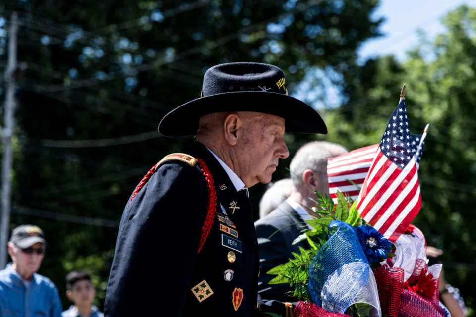 <strong>Officer Don Keith, U.S. Army, helps lay a wreath during Monday&rsquo;s Memorial Day Ceremony at Veterans Park in Bartlett.</strong> (Brad Vest/Special to Daily Memphian)