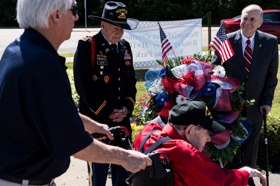 <strong>Officer Don Keith, U.S. Army, left, and Bartlett Mayor A. Keith McDonald, right, prepare to lay a wreath during Monday&rsquo;s Memorial Day Ceremony at Veterans Park in Bartlett.</strong> (Brad Vest/Special to Daily Memphian)